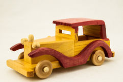 Wooden Toy Red and Yellow Car Stock Photo