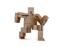 Wooden toy robot. Isolated object runs pine stock photo