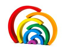 Wooden toy  rainbow. A wooden toy of seven different-colored arcs in the form of a rainbow on a white  background, the arcs are stacked on top of each other Stock Photography