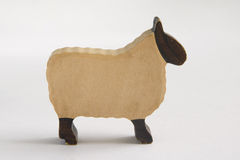 Wooden toy sheep. Carved wooden toy sheep from farmyard set Royalty Free Stock Photography