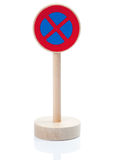Wooden toy sign: Stopping restriction (Halteverbot). Wooden traffic sign restricting standing,  on white with reflection on the stand Royalty Free Stock Photography