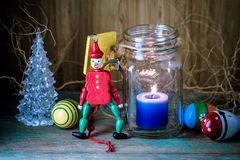 Wooden toy soldier in red uniform decoration and candle Stock Photo