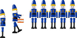 Wooden Toy Soldiers. Line of six wooden soldiers and drummer with one side profile Royalty Free Stock Photography