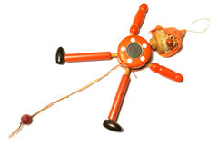 Wooden Toy Strong Pull Clown. On white background stock photo