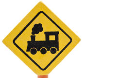 Wooden toy traffic sign: Railway crossing. Traffic sign made of raw wood with a warning for a railway crossing Royalty Free Stock Image