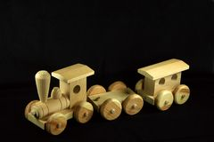 Wooden toy train. Isolated on black royalty free stock image