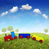 Wooden Toy Train. On a green hill Stock Image