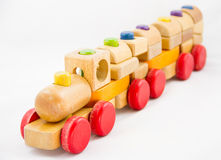 Wooden toy train. With colorful blocs on white background royalty free stock photos