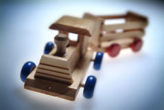 Wooden toy train. On blur background Royalty Free Stock Photos