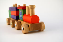 Wooden toy train. Child's toy train on a white background Stock Photography
