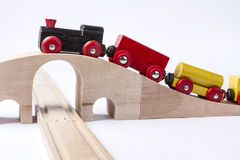 Wooden toy train on bridge Royalty Free Stock Images