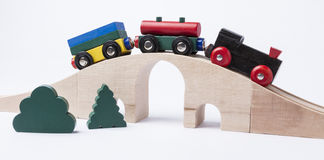 Wooden toy train on bridge Royalty Free Stock Photos