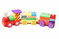 Wooden toy train for children. On white background Royalty Free Stock Photos