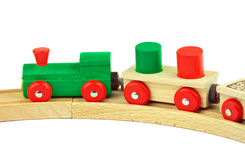 Wooden toy train. Wooden toy colored train isolated on white background Royalty Free Stock Image