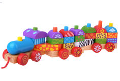 Wooden toy train with colorful blocks. Isolated over white Stock Image