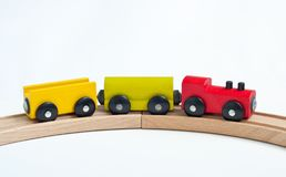 Wooden toy train with colorful blocks on a wooden railway. Educational toys.  royalty free stock photo