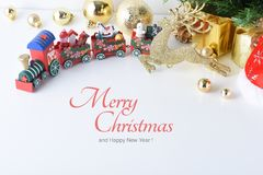 Wooden toy train with colorful blocs, Happy New Year, Christmas. Santa Claus hat with Celebration balls and other decoration stock image