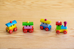 Wooden toy train with colorful blocs. Isolated on a wooden background stock photography