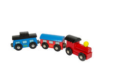 Wooden toy train with colorful blocs isolated. Over white royalty free stock photos