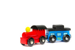 Wooden toy train with colorful blocs isolated. Over white royalty free stock photo