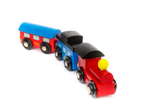 Wooden toy train with colorful blocs isolated. Over white royalty free stock photography