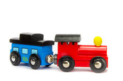 Wooden toy train with colorful blocs isolated. Over white royalty free stock image