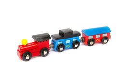 Wooden toy train with colorful blocs isolated Stock Image