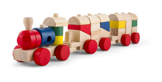 Wooden toy train with colorful blocs isolated over white. Background royalty free stock image