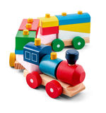 Wooden toy train with colorful blocs isolated over white Stock Photography