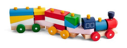 Wooden toy train with colorful blocs over white. Wooden toy train with colorful blocs isolated over white background royalty free stock photography