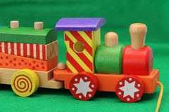 Wooden toy train. Coloured wooden toy train - Old games for young and old Royalty Free Stock Photo