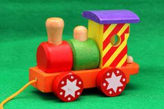 Wooden toy train. Coloured wooden toy train - Old games for young and old Royalty Free Stock Images