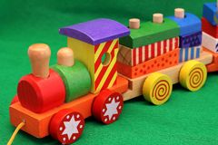 Wooden toy train. Coloured wooden toy train - Old games for young and old Stock Photo