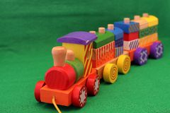 Wooden toy train. Coloured wooden toy train - Old games for young and old Royalty Free Stock Photography