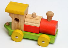 Wooden Toy Train. Colourful wooden toy train made up of smaller pieces Royalty Free Stock Photos