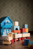Wooden toy train and doll house Stock Photography