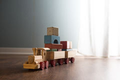 Wooden toy train on the floor Stock Photos