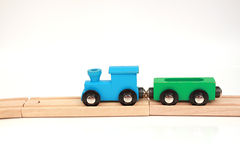 Wooden Toy Train. Isolated image of a blue and green toy wooden train on a track Royalty Free Stock Photo