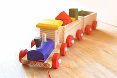 Wooden toy train over wooden floor. selective focus. retro filtered Stock Image