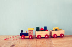 Wooden toy train over wooden table Royalty Free Stock Image