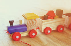 Wooden toy train over wooden table. Royalty Free Stock Images