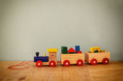 Wooden toy train over wooden table. retro filtered image Royalty Free Stock Images