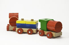 Wooden Toy Train. Painted in primary colors of red, green, blue, and yellow against a white background Royalty Free Stock Photo