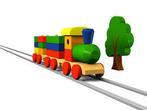 Wooden toy train on rails Stock Photos