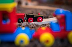 Wooden toy train on a room floor. Colourful wooden toy train on the carpet in the living room in the house stock photos