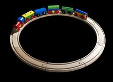 Wooden toy train on tracks Stock Images