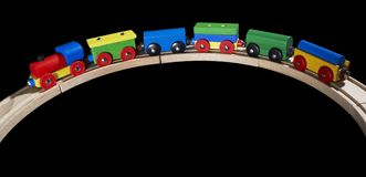 Wooden toy train on tracks Stock Photos