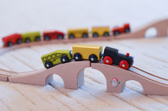 Wooden toy train on the tracks Stock Photo
