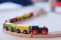Wooden toy train on the tracks Royalty Free Stock Photos