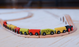 Wooden toy train on the tracks Stock Photos